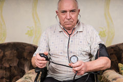 Senior Man with Sphygmomanometer and Stethoscope Stock Image