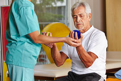 Senior man with spikey balls in gym royalty free stock images