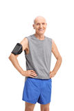 Senior man in sportswear listening to music on phone Stock Photo