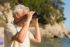 Senior man with spy glasses Stock Photography