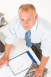 Senior man standing above office table Royalty Free Stock Image