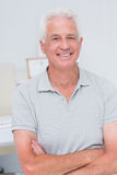 Senior man standing arms crossed in clinic Stock Photos