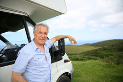 Senior man standing bycamping car Royalty Free Stock Images