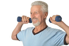 Senior man Standing With Dumbbell Royalty Free Stock Image