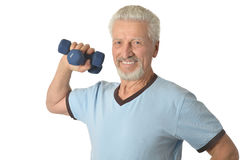 Senior man Standing With Dumbbell Royalty Free Stock Photo