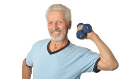 Senior man Standing With Dumbbell Stock Images