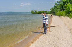 Senior man standing on the edge of the Dnepr river. Looking into the distance Stock Photos