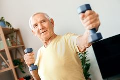 Senior man exercise at home health care with dumbbells front view royalty free stock image