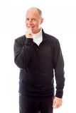 Senior man standing with finger in mouth Stock Photos