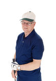 Senior man standing with golf hat. Royalty Free Stock Photos