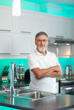Senior man standing in his modern kitchen Stock Photography