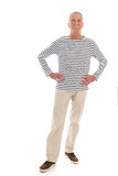 Senior man standing isolated over white background royalty free stock photos