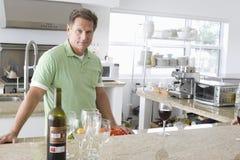 Senior Man Standing In Kitchen Royalty Free Stock Image