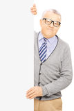 Senior man standing next to blank panel and posing Royalty Free Stock Photography