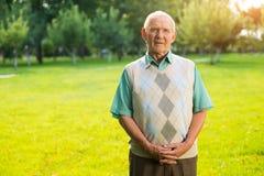 Senior man standing outdoors. Stock Photo
