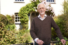 Senior Man Standing Outside Pretty Cottage Stock Photos