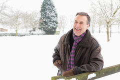 Senior Man Standing Outside In Snow Landscape Stock Image