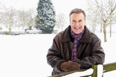 Senior Man Standing Outside In Snowy Landscape Stock Photography