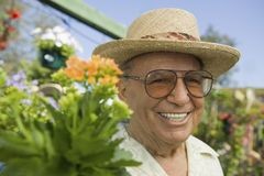 Senior Man standing in plant nursery portrait close up Stock Image