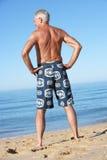 Senior Man Standing On Summer Beach Royalty Free Stock Image