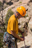 Senior man starting rock climb in Colorado stock photo