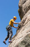 Senior man on steep rock climb in Colorado Royalty Free Stock Photos