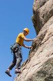 Senior man on steep rock climb in Colorado Royalty Free Stock Photos