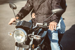 Senior man steering motorcycle on road Stock Photography