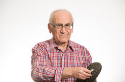 Senior man stepped in chewing gum royalty free stock photography