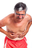 Senior man stomach ache Royalty Free Stock Images
