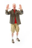Senior man stopping with hand gesture Royalty Free Stock Photography