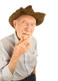 Senior man in straw hat. Handsome senior man wearing straw cowboy style hat Royalty Free Stock Image