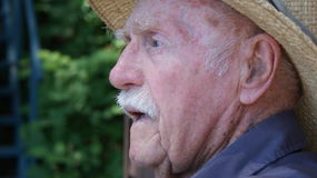 Senior man in straw hat. Age is a day of wonder for this senior man who wonder in garden work royalty free stock photo