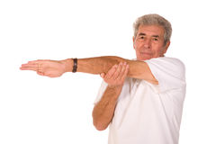 Senior man stretching Royalty Free Stock Images