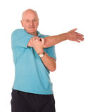 Senior man stretching Royalty Free Stock Photos
