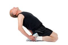 Senior man. Stretching. Senior man stretches before exercise Royalty Free Stock Photo