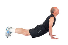 Senior man. Stretching. Senior man stretches before exercise Stock Photography