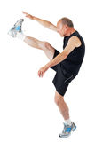 Senior man. Stretching. Fit senior man stretches before exercise Royalty Free Stock Photography