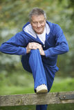 Senior Man Stretching On Countryside Run Royalty Free Stock Images