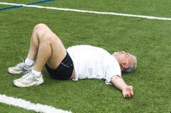 senior man stretching exercising Royalty Free Stock Photos