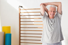 Senior man stretching Stock Images