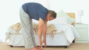 Senior man stretching himself stock footage