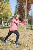 Senior Man Exercising In Park stock photography