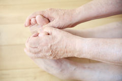 Senior man stretching to hold toes Royalty Free Stock Photo