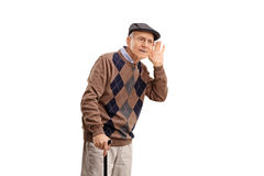 Senior man struggling to hear something. Studio shot of a senior man struggling to hear something isolated on white background Stock Images