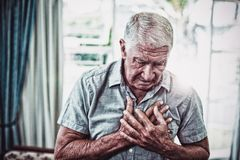 Senior man suffering from chest pain stock image