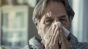 Senior man suffering from cold stock images
