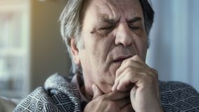 Senior man suffering from cold stock photo