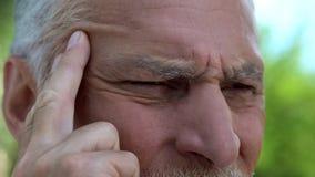 Senior man suffering eyesight problems, cataract disease, vision correction. Stock photo stock photo