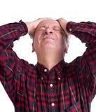 Senior man suffering from a headache Stock Photography